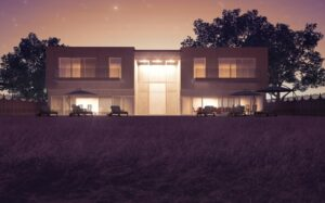 Modern villa with outdoor security lighting.