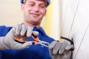 Close up of an electrician wearing gloves