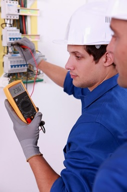 Electricians connecting the meter to a circuit and calculating readings