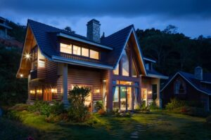a shot of a home with outdoor lighting at night