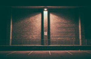Wall pack lights provide illumination to pedestrians