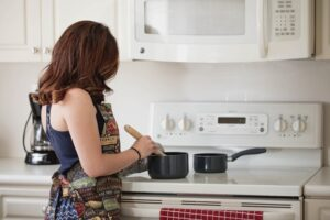 Woman cooking on an electric stove