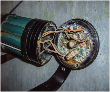 Burnt capacitor of a fuse box