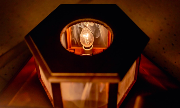 A bulb inside a lamp that is turned on