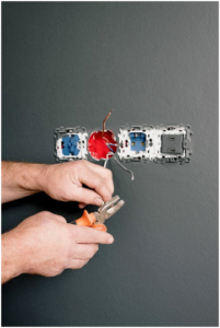 An electrician fixing wires