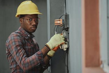 man repairing wiring