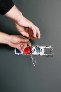 man making electrical repairs