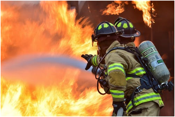 A fireman trying to control the fire