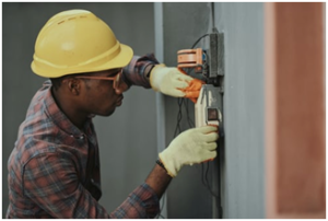 A man working on electrical circuits