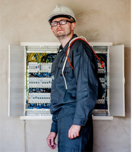 An electrician offering switchboard repair services in Cypress, TX